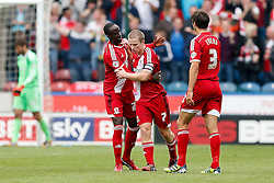 Grant Leadbitter of Middlesbrough celebrates scoring a goal with Albert Adomah and George Friend - Photo mandatory by-line: Rogan Thomson/JMP - 07966 386802 - 13/09/2014 - SPORT - FOOTBALL - Huddersfield, England - The John Smith's Stadium - Huddersfield town v Middlesbrough - Sky Bet Championship.