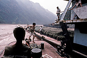 Traveling up the Yangtze on a barge which acts as a guide for other river boats and barges through the trecherous current of the Wu Gorge, China