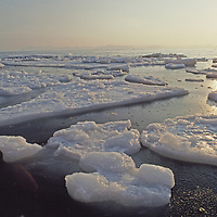 """Midnight sun over melting pack ice in Isfjorden (""""Ice Fjord"""")."""