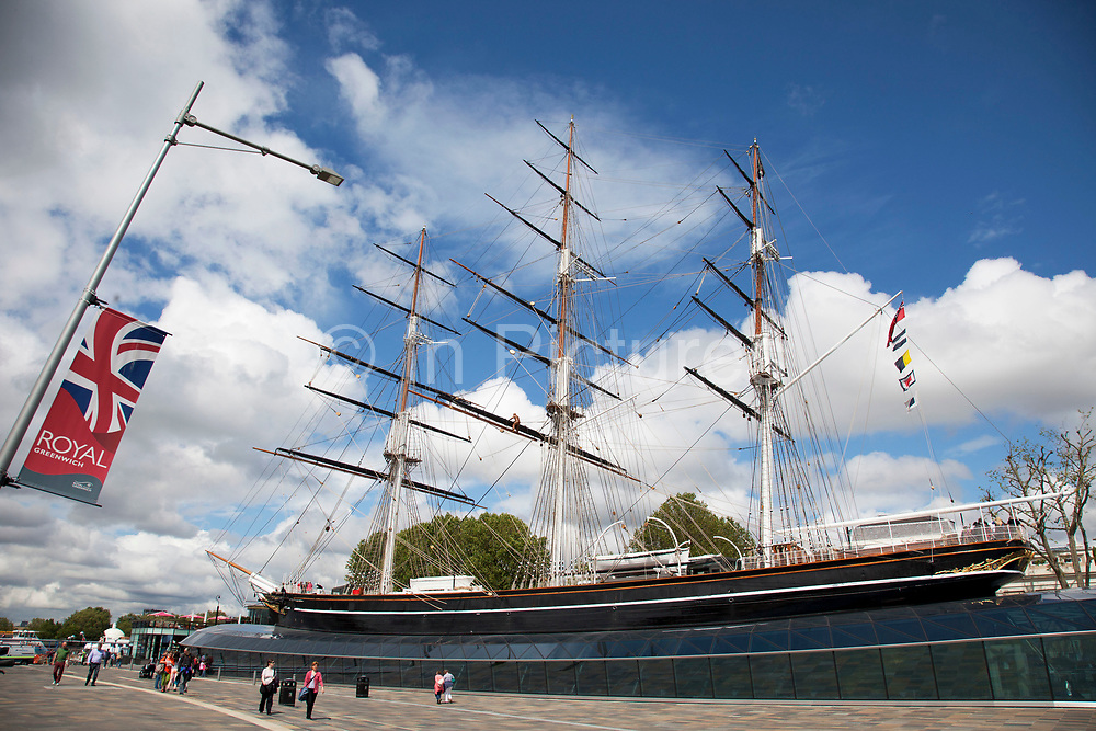 Cutty Sark at Greenwich in South east London, UK. The Cutty Sark is a clipper ship. Built in 1869 for the Jock Willis shipping line, she was one of the last tea clippers to be built and one of the fastest, coming at the end of a long period of design development which halted as sailing ships gave way to steam propulsion.