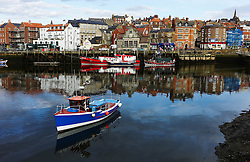 © Licensed to London News Pictures. <br /> 04/05/2016. <br /> Whitby, UK.  <br /> <br /> A fishing boat leaves its mooring before turning and heading for sea out of Whitby harbour in North Yorkshire.<br />   <br /> Photo credit: Ian Forsyth/LNP