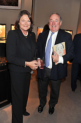 ANTHONY & ANTOINETTE OPPENHEIMER at a party to celebrate the launch of Carol Woolton's book 'Drawing Jewels For Fashion' held at Asprey, 167 New Bond Street, London W1 on 10th November 2011.