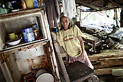 Michael, 60 years old, has spent more then 40 years in the Iwhaing Prison, he has a murder conviction..He has his own house inside the prison compound, lives with his family and his son and daughter has been born at the prison hospital and they never lived anywhere else, jan 2012.