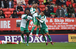 Plymouth Argyle's Graham Carey (centre) celebrates scoring his side's first goal of the game with team mates