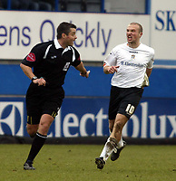 Photo: Chris Ratcliffe.<br />Luton Town v Watford. Coca Cola Championship.<br />02/01/2006.<br />Warren Feeney (R) of Luton remonstrates with referee I Williamson about a penalty which he did not give in the dying seconds.