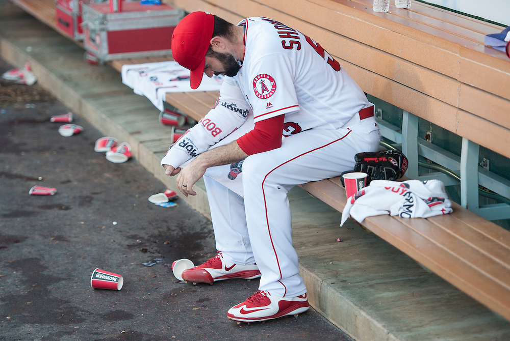 Starting pitcher Matt Shoemaker sits in the dugout between innings during the Angels' 3-0 loss to the Detroit Tigers Wednesday at Angel Stadium.<br /> <br /> ///ADDITIONAL INFO:   <br /> <br /> angels.0602.kjs  ---  Photo by KEVIN SULLIVAN / Orange County Register  -- 6/1/16<br /> <br /> The Los Angeles Angels take on the Detroit Tigers Wednesay at Angel Stadium.