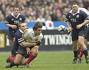 Saint-Denis, Paris, France, 23rd February 2003,  Six Nations Rugby International, France vs Scotland, Stade de France,<br /> [Mandatory Credit: Peter Spurrier/Intersport Images],<br /> Photo Peter Spurrier<br /> 23/02/2003<br /> Sport -SIX NATIONS RUGBY - France v Scotland<br /> Michael Blair clasps his arms around Franciois Gelez just after he relaesed the ball.