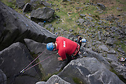 Climbing club and gritstone geology on Long Causeway cliffs, Peak District National Park, Derbyshire...Located in the Peak District National Park in England Stanage Edge is the largest of the gritstone edges that overlook Hathersage in Derbyshire. Stanage Edge at approximately 4 miles in length and 458m at its highest point is the largest of the gritstone cliffs that overlook Hathersage, Derbyshire. The area is one of the most popular locations in the Peak District National Park for climbing and walking with hundreds of rock climbing routes to challenge all ranges of ability. Walkers are drawn to the area to enjoy the varied moorland scenery with stunning views across the surrounding countryside including Hathersage, Castleton and the 'Shivering Mountain', Mam Tor in the west. A walk along the edge is an easy route but the exposed cliff can make conditions difficult throughout the year as it is often battered by wind, rain and regular snowfall in the winter months. There are a number of popular walks including routes along the remains of a Roman Road and towards Redmires Reservoir to the east as well as longer walks such as those including the nearby Longshaw Estate. Sopurce http://www.stanageedge.co.uk