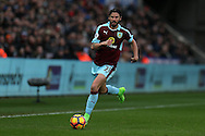 George Boyd of Burnley in action. Premier league match, Swansea city v Burnley at the Liberty Stadium in Swansea, South Wales on Saturday 4th March 2017.<br /> pic by Andrew Orchard, Andrew Orchard sports photography.