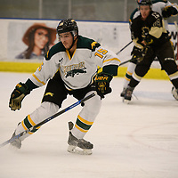 2nd year defence man Carter Hansen (15) of the Regina Cougars in action during the Men's Hockey home game on November 11 at Co-operators arena. Credit: Arthur Ward/Arthur Images