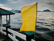Yellow flag floats in the wind on lake Taal, Luzon Island, Philippines, Southeast Asia, 2016