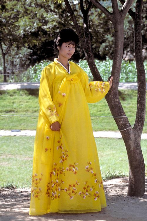 Korea: Asian woman dressed in hanbok, traditional Korean dress, in Folk Village near Seoul, Korea. ©Bob Daemmrich/