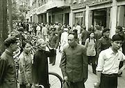 C012-4_Tom Hutchins_Family types, Sunday morning shopping,Wang Fu Chin, Peking 1956. damaged vintage print spotted.tif
