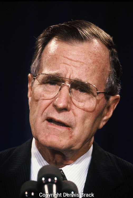 President Herbert Walker Bush answers questions at a press conference on the Gulf War Crisis on December 18, 1990.<br /> Photo by Dennis Brack