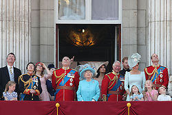 (left to right) Vice Admiral Sir Timothy Laurence, the Princess Royal, Princess Beatrice, Lady Louis Windsor, Duke of York, , Queen Elizabeth II, Duchess of Sussex, Prince of Wales, Duke of Sussex and the Duke and Duchess of Cambridge with Princess Charlotte, Savannah Phillips and Prince George, on the balcony of Buckingham Palace, in central London, following the Trooping the Colour ceremony at Horse Guards Parade as the Queen celebrates her official birthday.