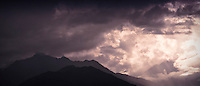 Storm clouds cross Mt Jupiter into the brighter Dosewallips River Valley in the Olympic Mountains, WA, USA.