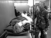 A wounded UN helicopter pilot shot down by Serbs during a ground battle for the town of Vukovar on the Danube River. In August 1991 the city was besieged and shelled by Serbian forces. Serbs later executed 3,000 citizens.