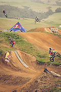 Freestyle Motocross riders getting some big air at Farm Jam 2016, Southland, New Zealand, sponsored by Red Bull