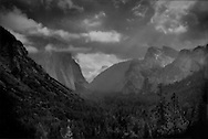 Summer storm clears over Yosemite Valley, yet Bridal Veil Falls (right) is still just a trickle, Sierra Nevada Mountains, California, USA.  Sierra Nevada Mountain valleys like the Yosemite Valley a natural reservoirs of water extremely sensitive to global warming and climate change.