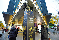 © Licensed to London News Pictures. 28/11/2019. LONDON, UK. Shoppers outside the Debenhams department store which is promoting discounts in Oxford Street, the capital's busiest shopping area, on the eve of Black Friday.  The US phenomenon of discounts for Thanksgiving has now been adopted by many retailers in the UK with several offering discounts during the prior week, instead of on the day itself.  Critics question whether some discounts offered on the day are cheaper than at other times.  Photo credit: Stephen Chung/LNP
