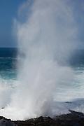 An ocean geyser created by powerful surf on Espanola Island, Galapagos Archipelago - Ecuador.