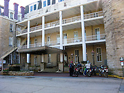 Dual sport motorcycle riders at Crescent Hotel in Eureka Springs, Arkansas
