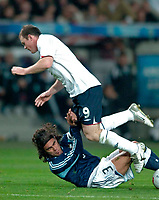 Photo: Glyn Thomas.<br />England v Argentina. International Friendly. 12/11/2005.<br />England's Wayne Rooney (R) is brought down by Juan Pablo Sorin.