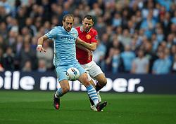 MANCHESTER, ENGLAND - Monday, April 30, 2012: Manchester City's Pablo Zabaleta in action against Manchester United's Ryan Giggs during the Premiership match at the City of Manchester Stadium. (Pic by David Rawcliffe/Propaganda)