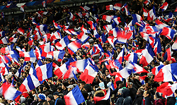 France fans wave flags in the stands during the International Friendly match at the Stade de France, Paris.