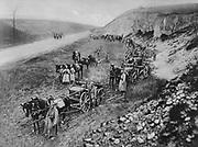 World War I 1914-1918: German horse-drawn machine gun unit pausing beside a road, 1915.  Military, Army,  Artillery, Weapon, Gun,  Automatic, Gun carriage