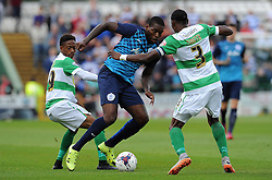 QPR's Jay Emmanuel-Thomas is tackled by Yeovil Town's Nathan Smith and Yeovil Town's Iffy Allen- Photo mandatory by-line: Harry Trump/JMP - Mobile: 07966 386802 - 11/08/15 - SPORT - FOOTBALL - Capital One Cup - First Round - Yeovil Town v QPR - Huish Park, Yeovil, England.