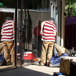 City of Austin  (TX) police supervise while city workers clean out a large homeless protest camp on the north side of City Hall mid-morning. Police arrested multiple homeless who refused to cooperate after several weeks of warnings and offers of assistance.