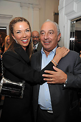 HEATHER KERZNER and SIR PHILIP GREEN at a party to launch the Georgina Chapman collection for Garrard held at Garrard, Albermarle Street, London on 4th November 2009.