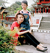 Sun Linang, 30 is a single, full-time mother to her daughter Du Jing Peng, 5. They are pictured at the 'Spendid China? miniature village park in Shenzhen, where they live. Linang is divorced but would like to find a new partner, ideally with no children of his own so that if they decided to have one together, they would not have to pay...Its over thirty years (1978) since the Mao's Chinese government brought in the One Child Policy in a bid to control the world's biggest, growing population. It has been successful, in controlling growth, but has led to other problems. E.G. a gender in-balance with a projected 30 million to many boys babies; Labour shortages and a lack of care for the elderly.