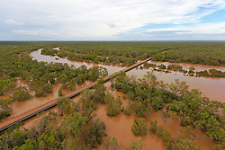The water laps at Willare Bridge as the flood waters keep rising. The 2011 wet season has been above average