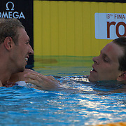 Cesar Cielo Filho, Brazil, (right) is congratulated by Alain Bernard of France after  winning the Men's 100m freestyle gold at World Swimming Championships in Rome on Thursday, July 30, 2009. Photo Tim Clayton.