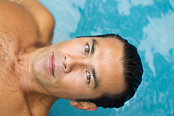 Asian American man above the water in a swimming pool