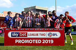 celebrate winning promotion from Sky Bet League Two to Sky Bet League One - Mandatory by-line: Robbie Stephenson/JMP - 13/04/2019 - FOOTBALL - Sincil Bank Stadium - Lincoln, England - Lincoln City v Cheltenham Town - Sky Bet League Two
