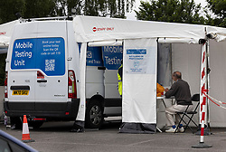 © Licensed to London News Pictures. 19/06/2021. Tattenham Corner, UK. A local resident takes a PCR covid-19 test at a mobile covid-19 test centre at Tattenham Corner, Surrey. Surge testing for the coronavirus is taking place in parts of Surrey after a rise in infections caused by the delta variant. Photo credit: Peter Macdiarmid/LNP