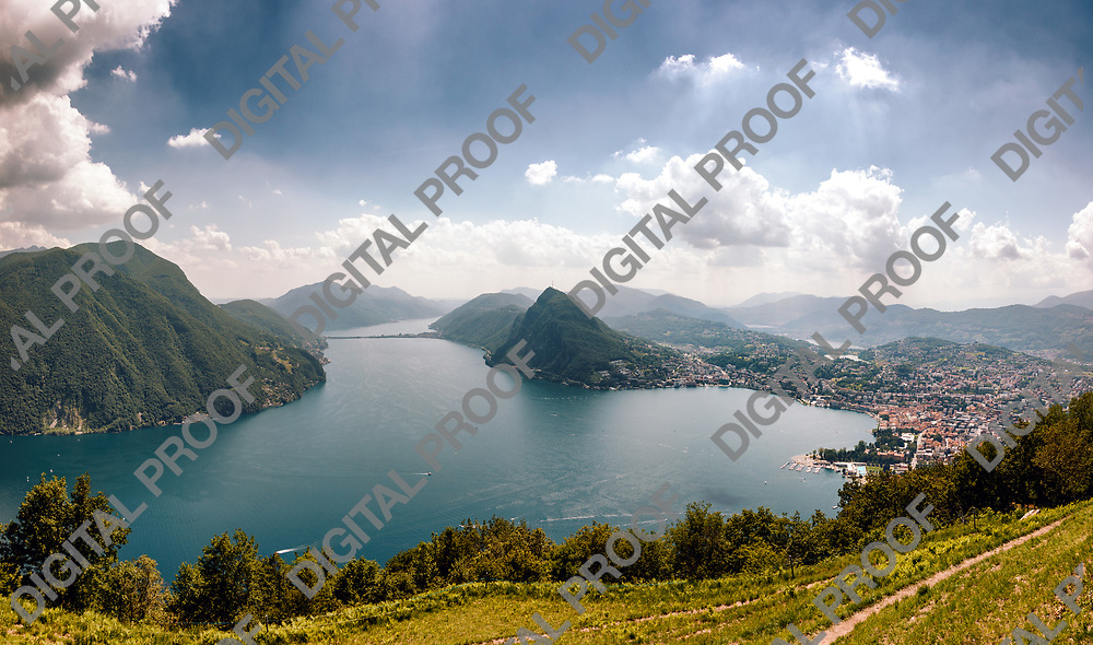 Panoramic view of the scenic Lugano Lake in Switzerland by day as seen from Mont Bre