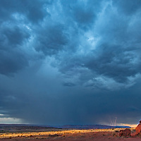 A thunderstorm and lightning hide the Bears Ears Buttes in Bears Ears National Monument, Utah.