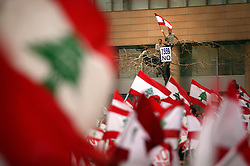 Hundreds of thousands of pro-Syrian protesters gather and chant anti-American slogans while waving Lebanon's flag, Beirut, Lebanon, March 8, 2005. Hezbollah, the militant Shiite Muslim group, called for a nationwide demonstration against foreign intervention and to counter weeks of massive anti-Syrian rallies.
