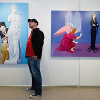 VENICE, ITALY - JUNE 01:  Artist Giuseppe Veneziano stands in front of one of his works at Galleria Contini on June 1, 2011 in Venice, Italy. Veneziano's controversial paintings portray  pop culture icons and historical figures.  (Photo by Marco Secchi/Getty Images)