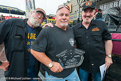 Editors Dean Shawler and Dave Nichols award a trophy at the very wet Easyriders Magazine Bike Show at the Easyriders Saloon during the annual Sturgis Black Hills Motorcycle Rally. SD, USA. August 5, 2014.  Photography ©2014 Michael Lichter.