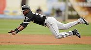SURPRISE, AZ - MARCH 06:  Alejandro De Aza #30 of the Chicago White Sox dives head first into second base against the Kansas City Royals on March 6, 2014 at The Ballpark in Surprise in Surprise, Arizona. (Photo by Ron Vesely)   Subject: Alejandro De Aza