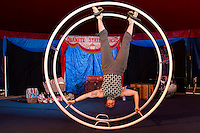 Abby Lively performs on the German Wheel inside the Granite State Circus at Weirs Beach.  (Karen Bobotas/for the Laconia Daily Sun)