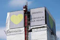 © Licensed to London News Pictures. 08/06/2018. London, UK. Banners of support are placed on top the Grenfell Tower ahead of the first anniversary of the Grenfell Tower fire which killed 72 people.. Photo credit: Ray Tang/LNP