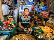 02 MARCH 2014 - MYAWADDY, KAYIN, MYANMAR (BURMA):  A shop owner in the market in Myawaddy, Myanmar. Myawaddy is separated from the Thai border town of Mae Sot by the Moei River. Myawaddy is the most important trading point between Myanmar (Burma) and Thailand.     PHOTO BY JACK KURTZ