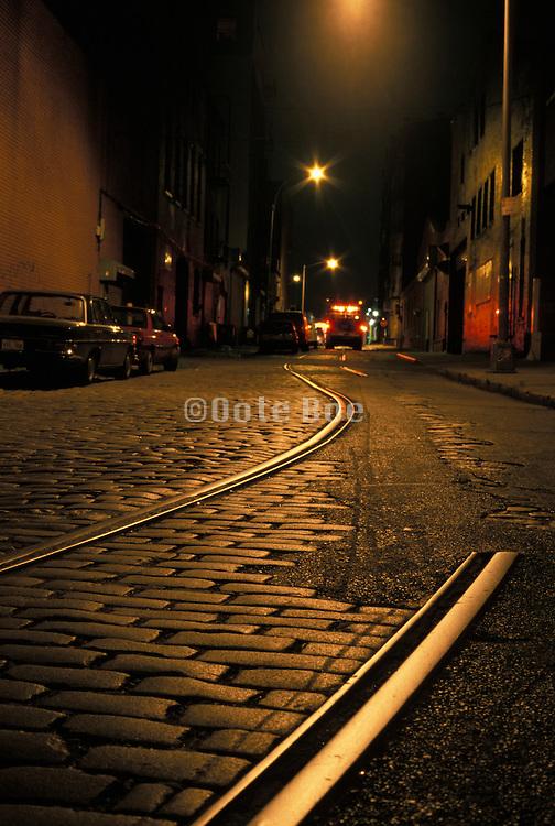 rail tracks on old cobbled road