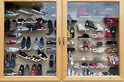 A detail of a Polish shoe shop window display, on 16th September 2019, in Zakopane, Malopolska, Poland.